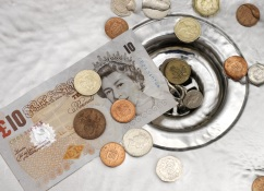 money-down-drain-uk-pounds